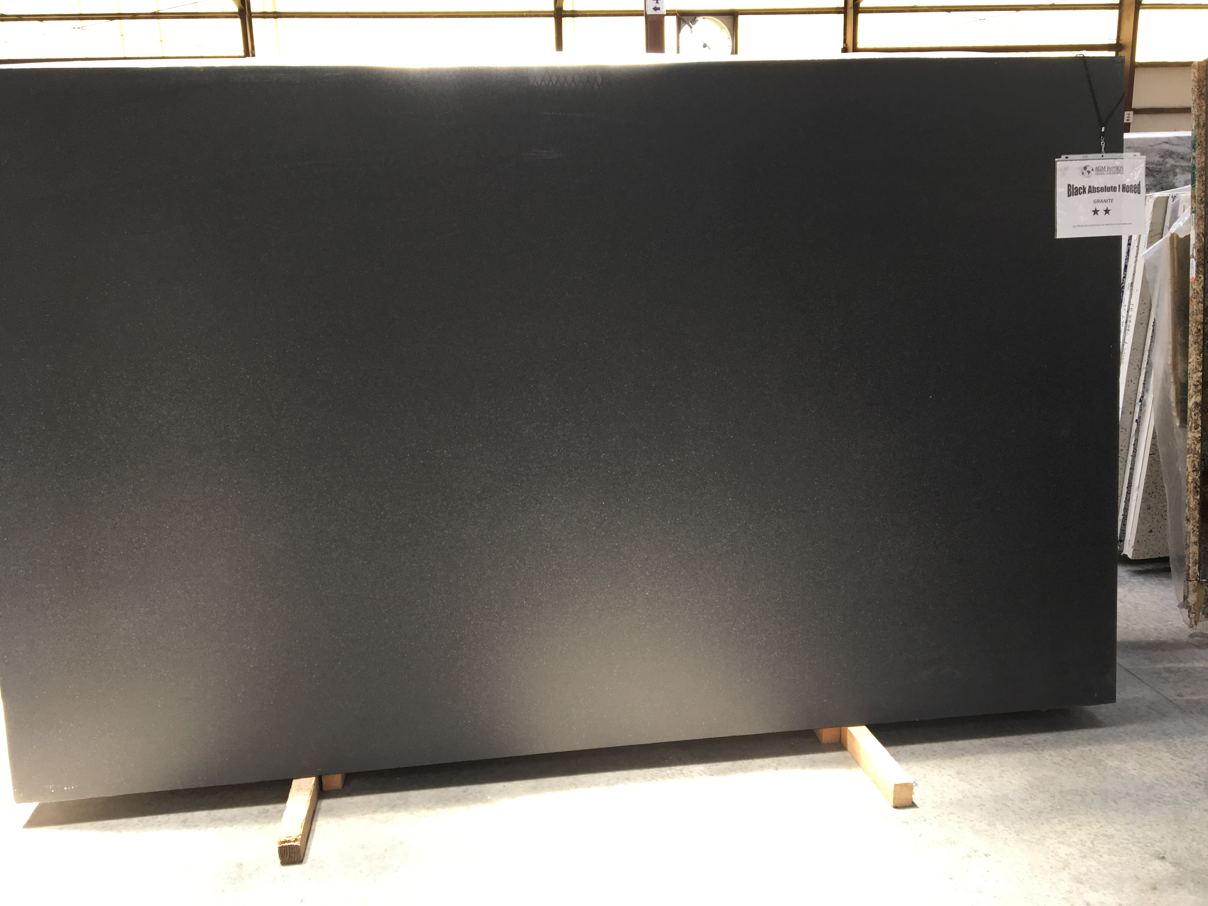 "Product Name: BLACK ABSOLUTE I HONED FF 3CM   Lot #: TAB3200    Avg. size: 126"" X 75"""