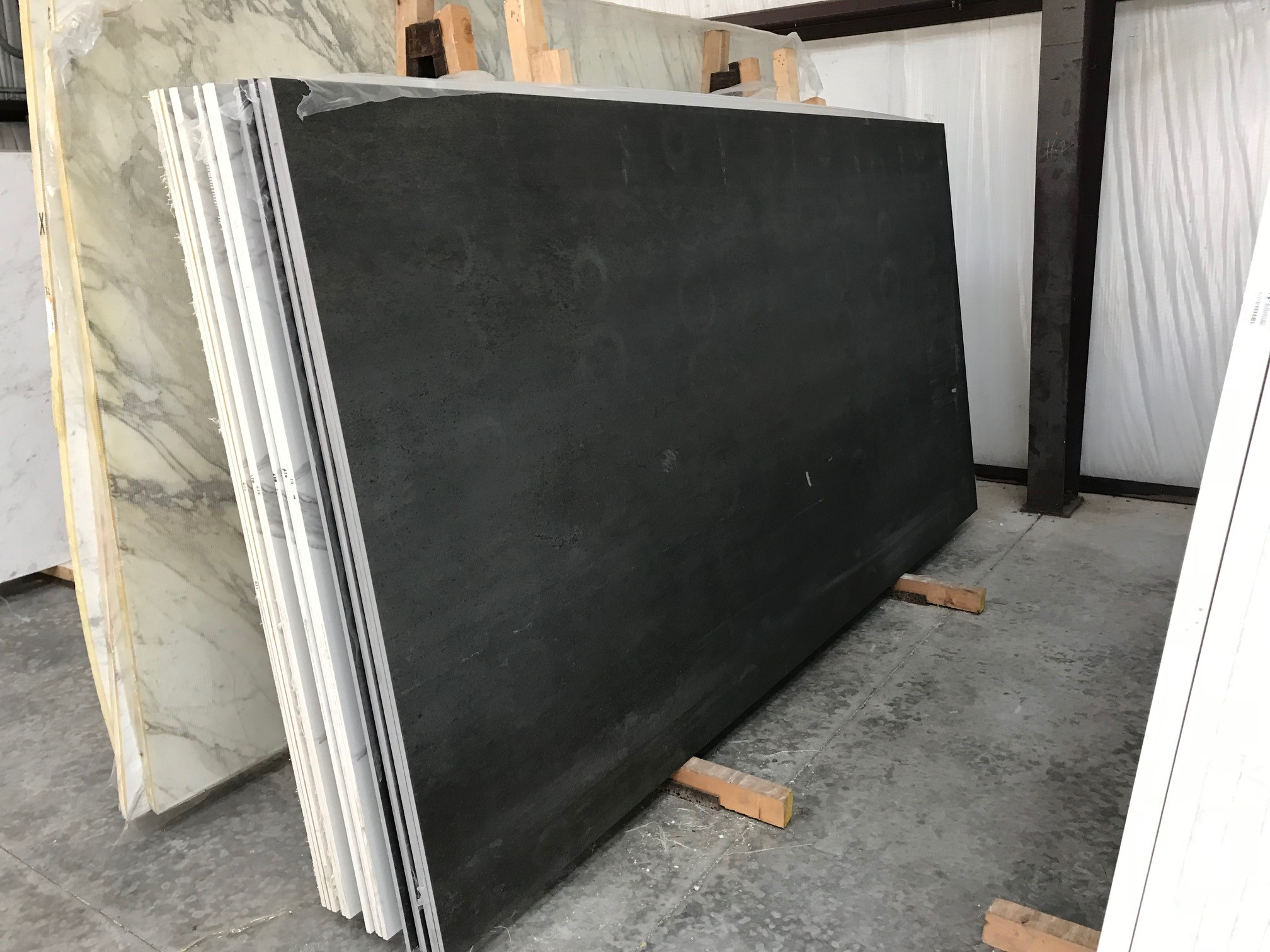 "Product Name: EPIC SUGAR BLACK PORCELAIN NATURAL 1.2CMLot #: FAV0949 Avg. size: 126"" X 63"""
