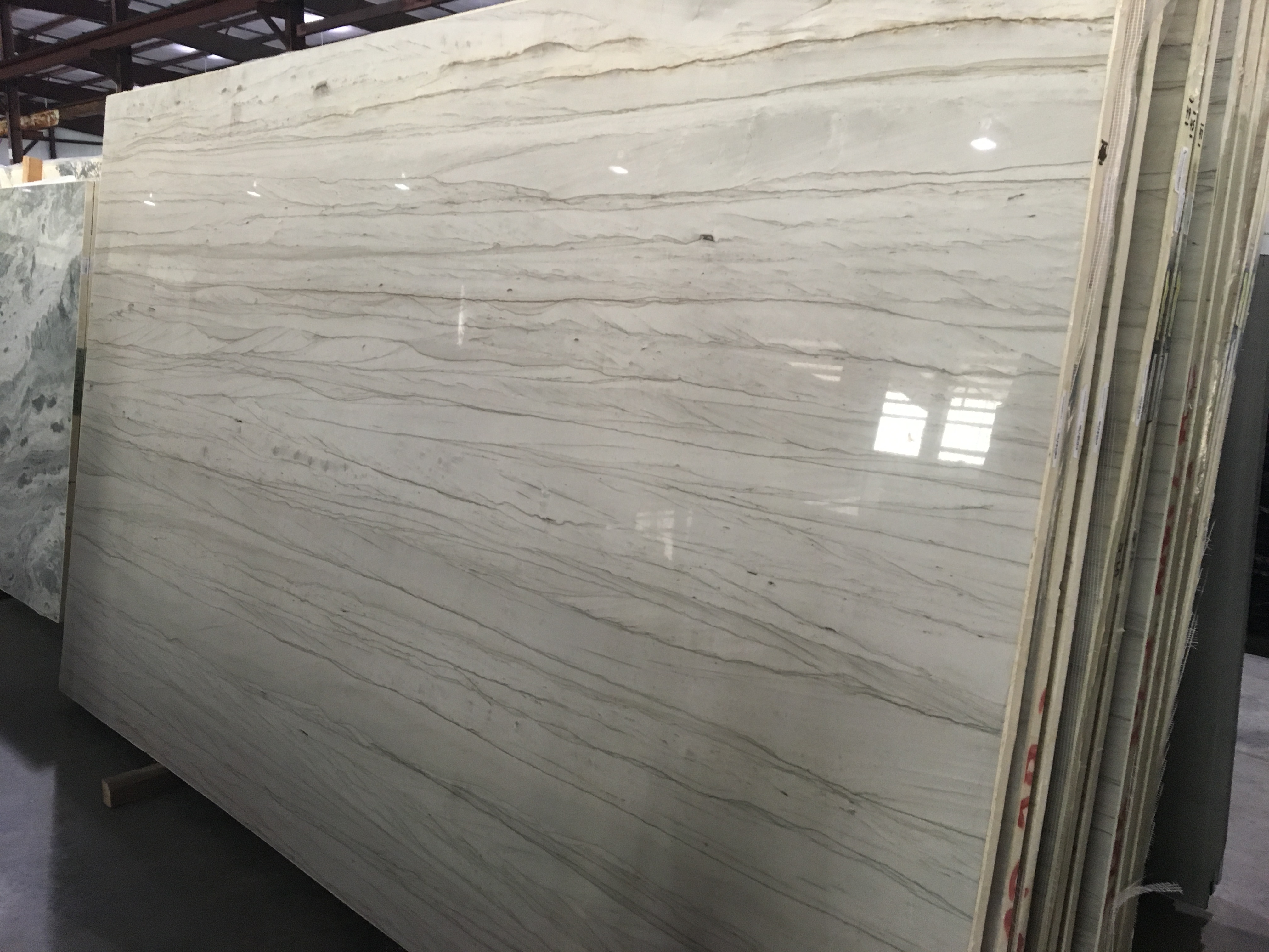 "Product Name: WHITE MUSTANG QUARTZITE LEATHER 3CM   Lot #: ARG2490    Avg. size: 129"" X 78"""